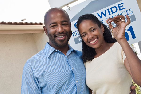 A couple of new home owners show off their brand new set of keys.