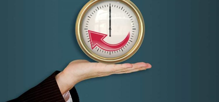 Hand holding a clock illustrating improved system life with maintenance from an Austin TX water softener company
