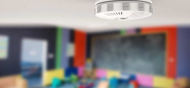 Carbon monoxide detector on the ceiling of a children's play room