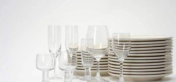 Shiny clean glasses and plates arranged in a still life